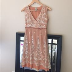 Anthropologie lace overlay dress Dress has gorgeous lace overlay. Has two small snags as pictured but other than that on good condition. Anthropologie Dresses