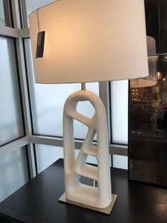 The unique form of the Wilcott Lamp from Arteriors Home creates interest and intrigue. The sculptural faux marble base has been crafted into an arched, open design that captures a dimensional quality.  The entire structure is fashioned to a hexagon antique brass base for an additional geometric appeal. The narrow silhouette of the Wilcott from Arteriors Lighting makes it a great beside luminary. Topped with an ivory microfiber drum shade and a matching metal finial. *Finish may vary.