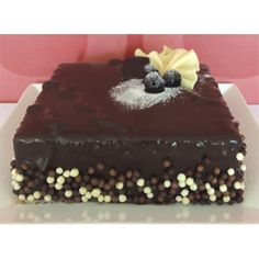 Doukissa Square Cake in Cyprus - Children's favourite rich chocolate fudge cake with marie biscuits covered with nutella.