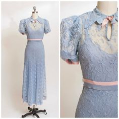 Vintage 1930s gown with matching slip. Made of sheer net pastel blue floral tambour lace. Comes with matching blue celanese bias cut slip. Hidden