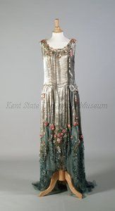 Dress by Boué Soeurs, 1928.Brocade silver lame, blue net, silk floral trim, sequins. Image c. Kent State University Museum.