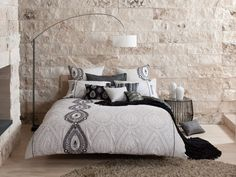 This lovely duvet cover features a modernized ethnic design with a subtle grey tonal scheme, creating a unique look for your bedroom. Bold accent colors and embellishment techniques add to the stylish design.
