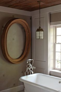 The simple beauty of an empty frame is sublimely on display in this serene bath..