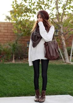 I love this fall outfit with the HUGE white sweater, large chunky scarf, black jeans, combat boots, beanie, and big purse. Very cute outfit for traveling in the fall, or for walking around the entire day in fall.