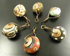 Beads by Joanne Zekowski of Z Beads.  Apparently she only sells at shows.  Going to look for her at Bead & Button!