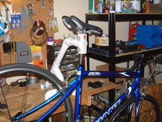 A simple and inexpensive bike repair stand for the bench-top. It's not quite as sturdy as the commercial floor-standing models but it works really well and you can spend the money you save on that Campy derailleur set you've always wanted.