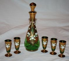 Vintage Emerald Green Glass Decanter Set with Gold Overlay and Enamel Floral Design with 5 matching glasses
