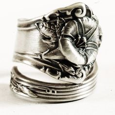 Beautiful and ornate sterling silver spoon ring by Alvin Co! Depicted in great 3-D detail is a delicate Morning Glory in bloom. Immaculate detail remains on the front and back of the spoon, all framed by lovely rails. This design was made by Alvin Co. in 1909. Morning Glories are the