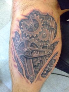 temoprary hand-drawn tattoo of gears on side of temple