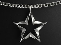 Check out Twisting Star Pendant by InterstellarCreations on Shapeways and discover more 3D printed products in Pendants and Necklaces.