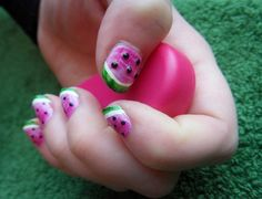 "Watermelon    A colorful take on a classic French manicure gets even more fun with the addition of black dot ""seeds."" Using tiny black beads or sequins looks great with this paint job."