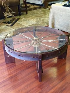 Wagon wheel coffee table  Metal wagon wheel, black walnut.
