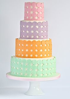 Swirls Bakery -  symmetrical rows of circular pastel rounds on a tall cake would make a great centrepiece at a pastel themed #wedding #pastels