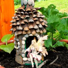 Make a simple fairy house using a plastic bottle as a base (tutorial with photos)