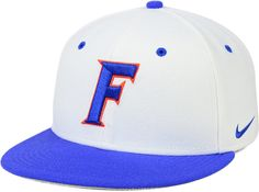 Accentuate your game-day attire and casual outfits with this Nike NCAA True College fitted cap. This officially licensed cap features a flat bill and high-quality Florida Gators logo at the front. High crown Structured fit Flat bill Embroidered team logo at front Nike swoosh logo at left side Team graphic at back Six panels with eyelets Fitted Wool/cotton Spot clean only