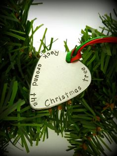 These would make great teachers gifts or gifts for family friends- even add their last name on it! Hand Stamped Guitar Pick Christmas Ornament by SnappinStudio, $13.00