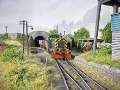 Model Railways of Chris Nevard. I love how he has hidden the route off the layout with the bridge.