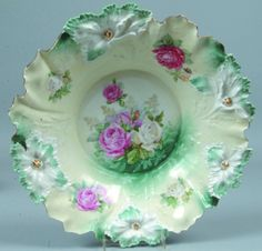 """RS Prussia Centerpiece Bowl, 15""""d.; Mold 28, Carnation, FD 3, pink and white roses and leaves on cream ground with blue-reen accents and gold highlights to mold features"""