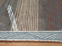 Vicus.org.uk: discussion of warp weighted looms, including card-woven headers and selvages.