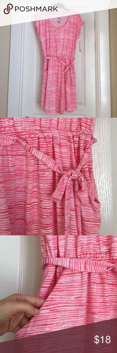 Striped Pink Dress The colors in the dress are different shades of pink and not red. Soft material - 70% polyester. Perfect for spring or summer! The dress also has two pockets on the sides. Sonoma Dresses Midi