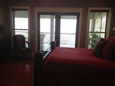 Master bedroom view of lake with double doors that open to porch.