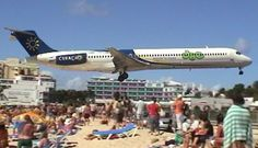 Amazing Plane landing and take-off footage at Maho Beach St Maarten How often do they have to replace that fence? ....Duck!!!