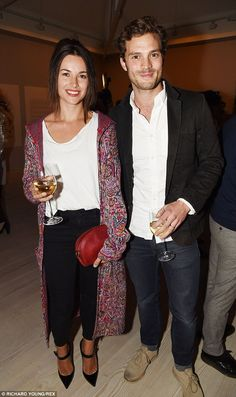 Smitten: Meanwhile, Jamie is happily married to actress Amelia Warner - pictutred together...