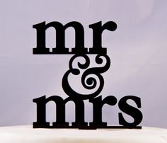 Wedding Cake Topper Mr and Mrs with ampersand design 3. $14.95, via Etsy.