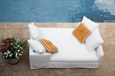 Nothing goes better with Sunday brunch than orange, right?⠀ ⠀ Sit poolside with US112-95 Nandina Outdoor Slipcovered Double Chaise in Spinnaker Salt, Shown w/ Extra Contrasting Throw Pillows⠀ by @leeindustries⠀  #design #interior4all #finedesign #interiordesign #interiorstyling #lovedesign #homedecor #interiors #interiorstudio #designstudio #njinterior #leeindustries #leeindustriesllc #outdoorseating #patio #poolside #summerdesign #sectional #chaiselounge #outdoorchaise #outdoordesign