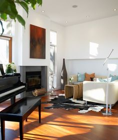 White walls and minimal decorating are the classic backdrop to any formal living room.