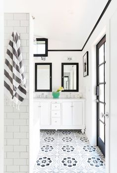 Love this black and white patterned tile floor in this bathroom.