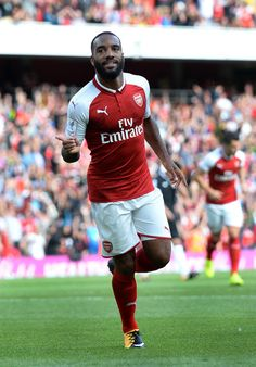 Arsenal's French striker Alexandre Lacazette celebrates scoring the team's first goal during the pre-season friendly football match between Arsenal and Sevilla at The Emirates Stadium in north London on July 30, 2017, the game is one of four matches played over two days for the Emirates Cup. / AFP PHOTO / OLLY GREENWOOD