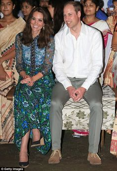 The Duchess of Cambridge and Prince William watch dancing by the fireside during a Bihu Festival Celebrationat Diphlu River Lodge on day 3 of the royal visit to India and Bhutan