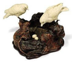 Japanese ivory and wood okimono, two birds looking after a nest of eggs,  by Mitsuyuk, Meji period.