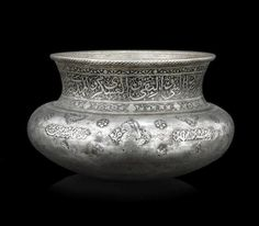A Safavid tinned-copper money bowl  Persia, dated AH 1073/AD 1662-63