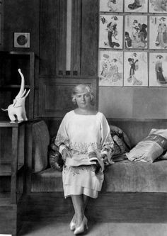 The couturier Madeleine Vionnet poses with an elephant, in a photo taken in the 1920s.