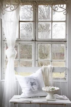 Breakfast nook - this whole window is gorgeous from the metal scrollwork to the sheet tied to the left side of the window.