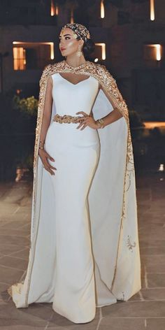Mermaid Wedding Dresses mermaid wedding dresses simple with cape gold trendy said mhamad official - Women's lace wedding dresses with sleeves is considered to be one of the most relevant models this season.Lace wedding dress is stylish at all times. Elegant Wedding Gowns, Dream Wedding Dresses, Designer Wedding Dresses, Elegant Dresses, Bridal Dresses, Beautiful Dresses, Wedding Dress Cape, Fancy Dresses For Weddings, Wedding Dress With Gold