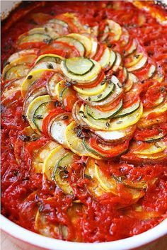 Layered Ratatouille (gluten free, vegan), 2 garlic cloves, very thinly sliced 1 cup tomato puree ¼ tsp. oregano ¼ tsp. crushed red pepper flakes 2 tablespoons olive oil, divided 1 small eggplant, such as Italian or Chinese 1 zucchini 1 yellow squash 1 long red bell pepper Few sprigs fresh thyme Salt and pepper bake at 375F for 45-55 min – More at http://www.GlobeTransformer.org