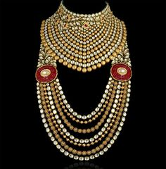 An opulent gold necklace rendered regal with uncut diamonds by Mahesh Notandass previewed by WeddingSutra.