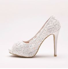 Ivory lace shoes are decorated with embroidered guipure and small pearls. Organza ribbons are used to tie them up. Shine throughout your wedding! :)