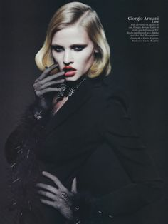 Shades of the Weimar Republic photographed by Mario Sorrenti for Vogue Paris, February 2011. Model: Lara Stone. Suit: Armani. Styled by Carine Roitfeld.