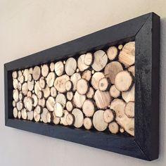 Tableau design en rondins de bois avec cadre noir
