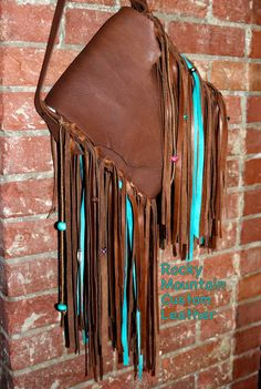 Handmade leather & fabric creations by Rocky Mountain Custom Leather