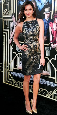 May 2, 2013  Nina Dobrev WHAT SHE WORE At the New York Premiere of The Great Gatsby, Dobrev channeled the era in a Black and Gold Cocktail Dress, Jeweled Jimmy Choo clutch and metallic Rupert Sanderson pumps.