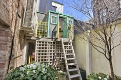 This Charming West Village Townhouse Boasts a Backyard Treehouse Above Its Garden
