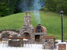 The MOST Beautiful Outdoor Fireplace and Wood-Fired Brick Pizza Oven on Pinterest!  But that's our biased opinion.  BrickWoodOvens.com
