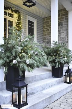 Christmas front porch decor with fresh greenery and the twinkling white lights sets a magical scene to welcome your guests! #diy