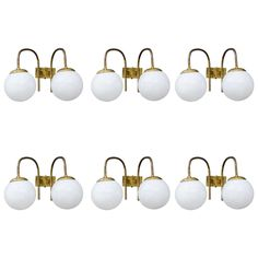 Set of Six Brass and Glass Wall Sconces | From a unique collection of antique and modern wall lights and sconces at https://www.1stdibs.com/furniture/lighting/sconces-wall-lights/