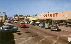 From Vintage Point Loma:    This picture is not mine, but it's a favorite that I've found while searching for good old photo's of OB. This is Newport looking west between Sunset Cliffs and Bacon. Cornet 5 & Dime is now the big Antique Store across from OB Warehouse. Next time you go into that antique place, go back to their little coffee counter and look at the photo on the shelf behind the counter. Its another great photo of their storefront as Cornet.